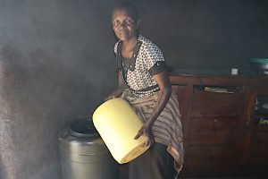 The Water Project:  Pouring Water Into A Storage Container