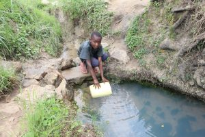 The Water Project:  Balancing To Fetch Water