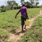 The Water Project: Mukhuyu Community, Gideon Kakai Chelagat Spring -  Boy Carrying Water