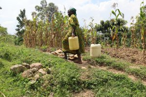 The Water Project:  Carrying Water On A Steep Hill