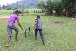 The Water Project:  Children Racing Their Cars