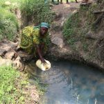 The Water Project: Mukhuyu Community, Gideon Kakai Chelagat Spring -  Fetching Water