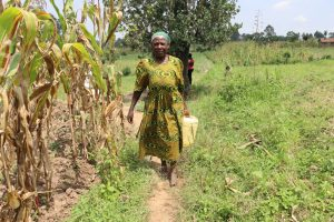 The Water Project:  Madam Kakai Carrying Water