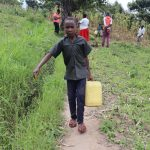 The Water Project: Mukhuyu Community, Gideon Kakai Chelagat Spring -  Stephen Carrying Water