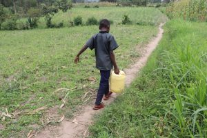 The Water Project:  Stephen Carrying Water Home