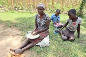 The Water Project:  Betty Hand Shelling Maize