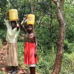 The Water Project: Mukhonje B Community, Peter Yakhama Spring -  Carrying Water