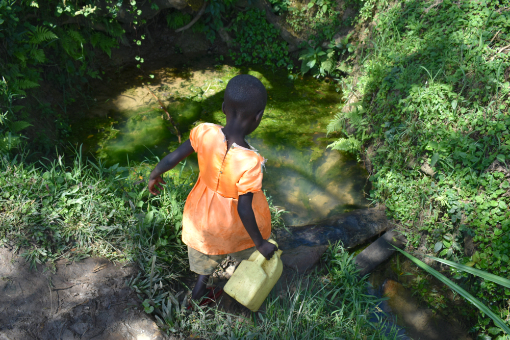 The Water Project : kenya20227-heading-to-fetch-water