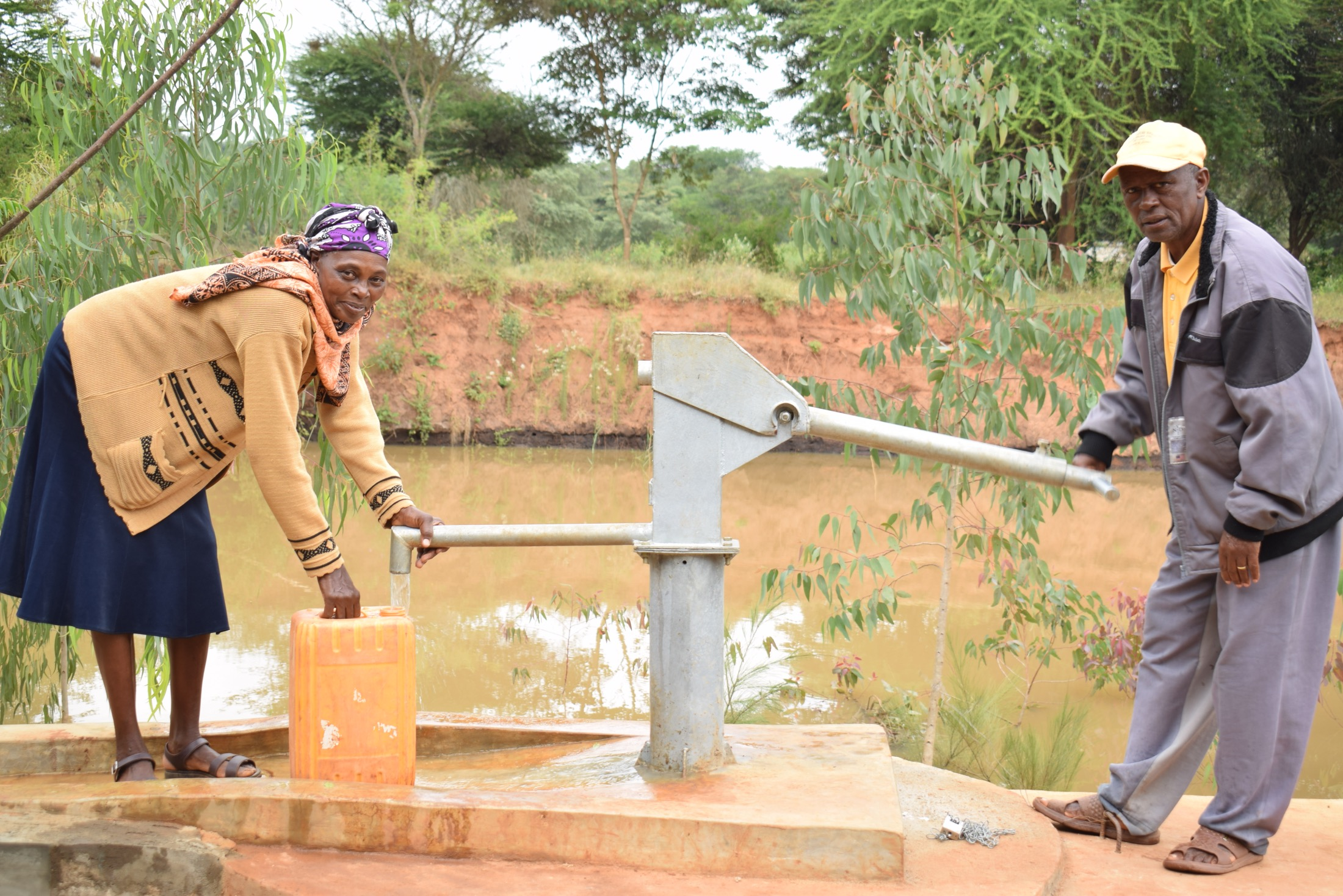 The Water Project : kenya20305-fetching-water-a-the-new-well