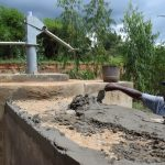 The Water Project: Kiteta Community A -  Finishing Well Cement