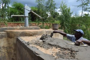 The Water Project:  Finishing Well Cement