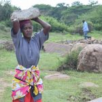 The Water Project: Kiteta Community A -  Woman Carrying Rock