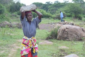 The Water Project:  Woman Carrying Rock