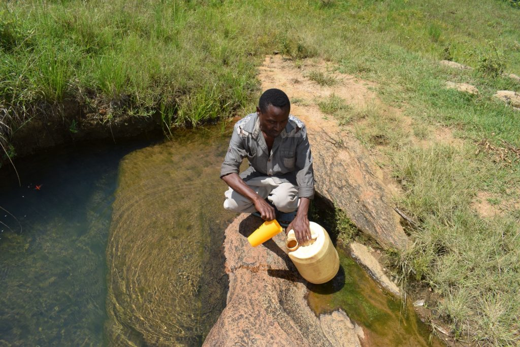 The Water Project : kenya20326-20327-fetching-water-at-the-open-source