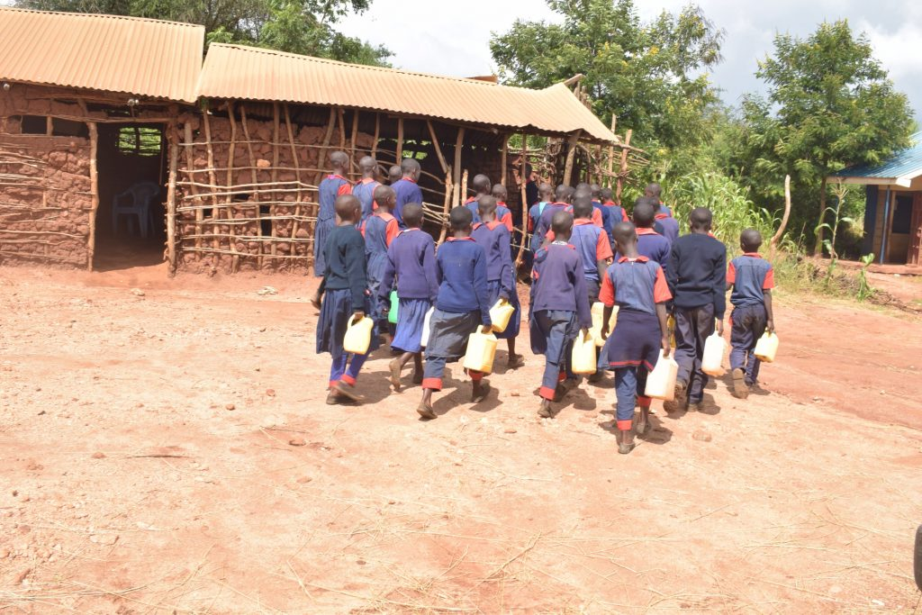 The Water Project : kenya20365-students-walking-with-water-containers