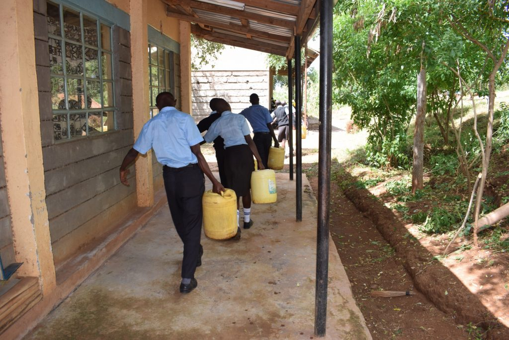 The Water Project : kenya20369-students-carrying-water