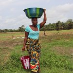 The Water Project: Rosint Community, #24 Poultry St -  Woman Carrying Water