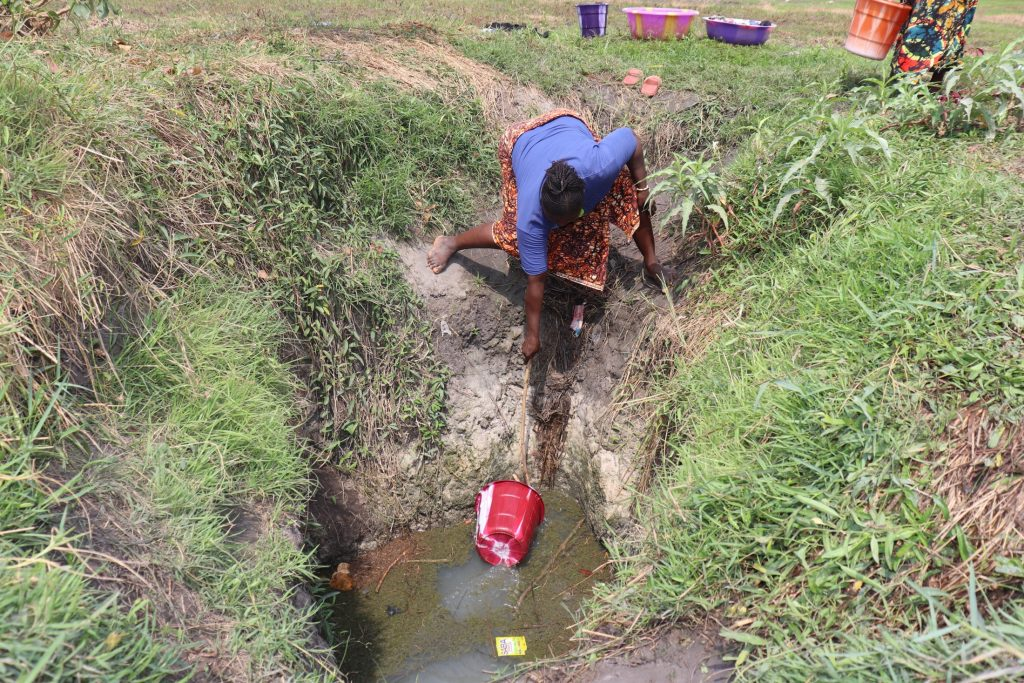 The Water Project : sierraleone20428-woman-collecting-water-2