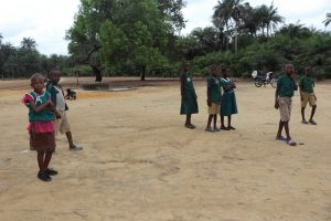 The Water Project:  Students Outside Classroom