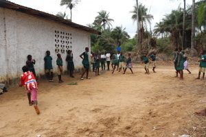 The Water Project:  Students Playing Local Game Called Balance Ball