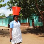 The Water Project: Kaffu Bullom, Kasongha OIC Vocational School -  Student Carrying Water