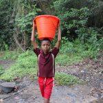 The Water Project: Lokomasama, Kalahire Junction -  Small Boy Carrying Water