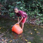 The Water Project: Lokomasama, Kalahire Junction -  Small Boy Collecting Water At Alternate Water Source