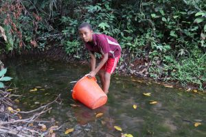The Water Project:  Small Boy Collecting Water At Alternate Water Source