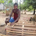 The Water Project: Lokomasama, Kalahire Junction -  Young Boy Making Local Bed For Resting