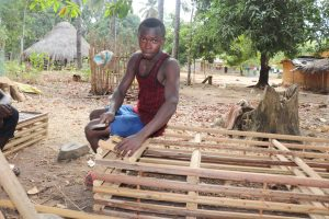 The Water Project:  Young Boy Making Local Bed For Resting