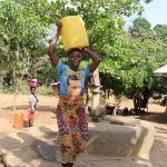 The Water Project: Lokomasama, Kalahire Junction -  Young Girl Carrying Water