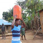 The Water Project: Lokomasama, Kalahire Junction -  Young Man Carrying Water