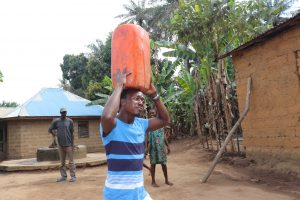 The Water Project:  Young Man Carrying Water