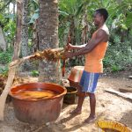 The Water Project: Lokomasama, Kalahire Junction -  Young Man Processing Palm Oil