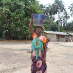The Water Project: Lokomasama, Bofi Village -  Woman Carrying Water