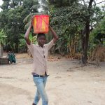 The Water Project: Lokomasama, Bofi Village -  Young Boy Carrying Water