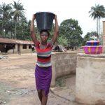 The Water Project: Lokomasama, Matong Village -  Small Girl Carrying Water