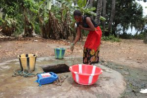 The Water Project:  Woman Collecting Water At Alternate Water Source