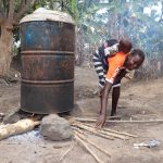 The Water Project: Lokomasama, Matong Village -  Woman Cooking Palm Oil Seeds For Palm Oil Processsing