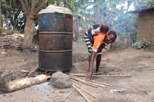 The Water Project:  Woman Cooking Palm Oil Seeds For Palm Oil Processsing