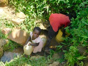 The Water Project:  Collecting Water From Olando Spring