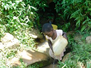 The Water Project:  Rinsing Her Container Before Fetching