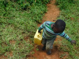The Water Project:  Taking Water Home From Olando Spring