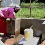 The Water Project: Litinye Community, Shivina Spring -  Fetching Water From Shivina Spring