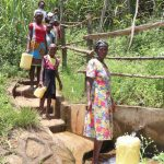 The Water Project: Sharambatsa Community, Mihako Spring -  Anne Fetching Water