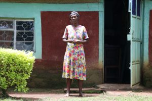 The Water Project:  Anne In Front Of Her House