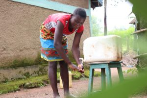The Water Project:  Faith Cleaning Her Hands