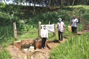 The Water Project:  Pius Christopher And Mrs Okanga At The Spring