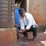 The Water Project: Irumbi Community, Okang'a Spring -  Pius Washing His Hands At His Home Rain Tank