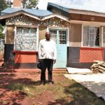 The Water Project: Irumbi Community, Okang'a Spring -  Sir Pius Outside His House